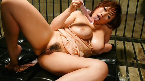 Busty Neiro Suzuka uses a big asian dildo to get off